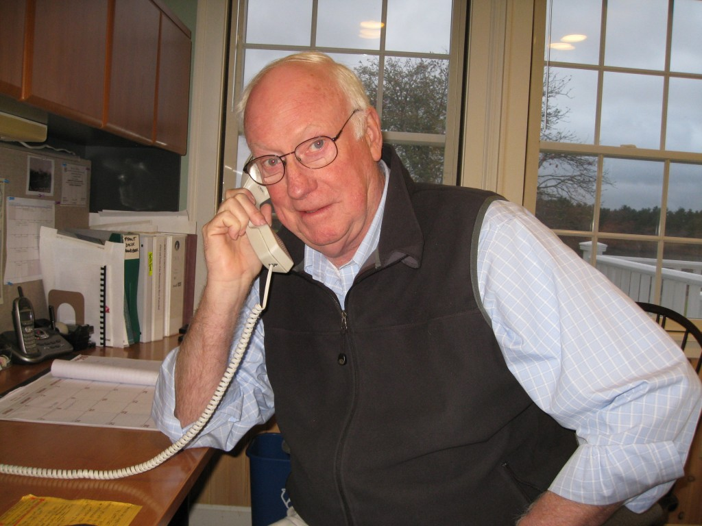Dennis McKenna at the Desk Front Office Volunteers