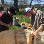 Trever Coffin helps David Moses Bridges build a wigwam