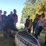 students learn about traditional canoe building