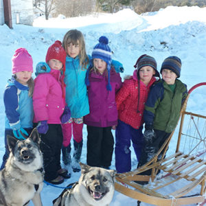 dogs and kids ready to go dogsledding