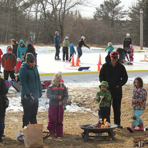 marshmallows and ice skating at winter fest