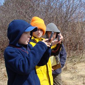 three boys using compasses
