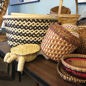 a selection of woven baskets by Judy Dow