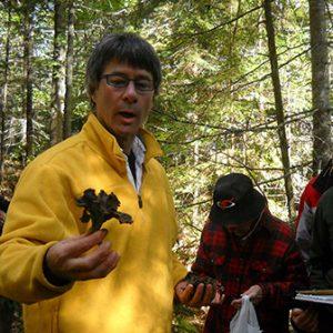 Greg Marley identifying a mushroom