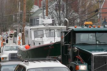 hauling a boat down Main Street