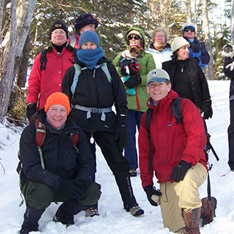 hikers on a snowy trail
