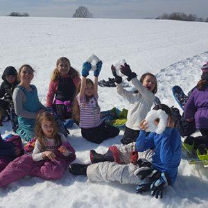 kids making snow rings
