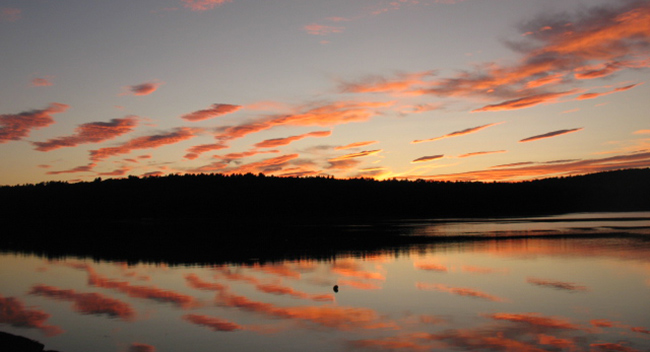 beautiful clouds at sunset reflected on the water