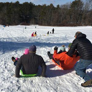 lots of people sledding