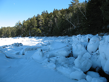 piles of river ice along the shore