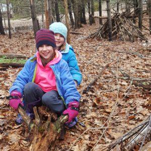 kids on a log, smiling