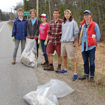 Lincoln Academy students cleaning up roadside trash