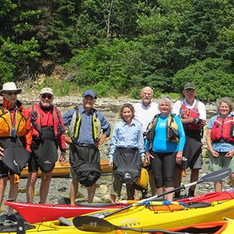 kayakers posing at the shore
