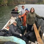 volunteers with a boatload of trash