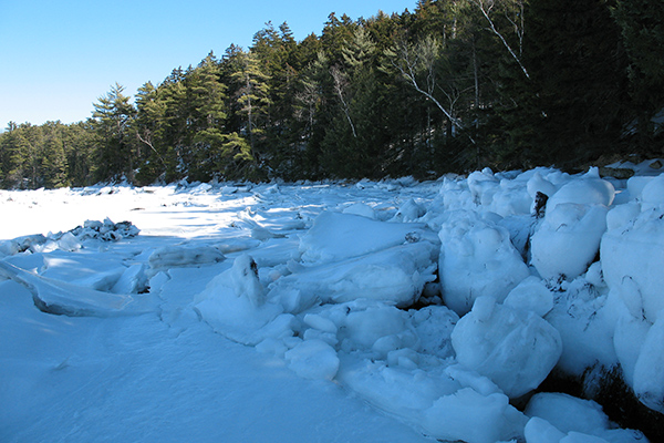 blocks of ice on the river shore