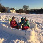 kids in a snow fort at salt bay farm