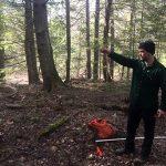 Noah Begin taking a measurement at Castner Creek