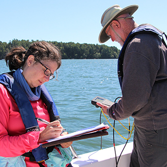 volunteers record water quality data in the estuary