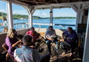 musicians overlooking the harbor